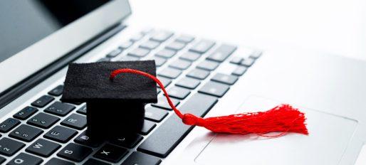 Graduation hat on computer keyboard